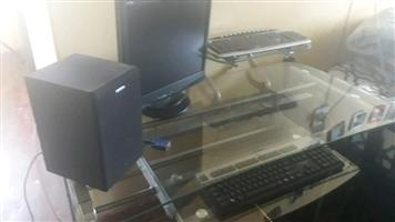 Desktop computer with 2 keyboards2 towers & speaker and  glass workstation