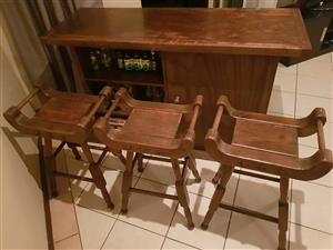 Bar counter with 3 chairs