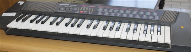 S035237A Casio keyboard with adaptor #Rosettenvillepawnshop