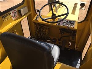 Bell tractor dumpers