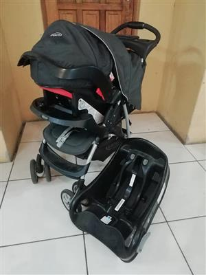 Black graco pram and booster seat