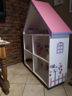 Doll house for sale with furniture.