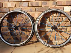 """Blue 24"""" Spinergy LX Flexrim Wheels with Schwalbe Marathon Plus Tires"""