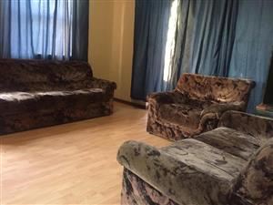 Brown suede lounge suite for sale
