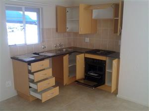 REF: PS159. First floor, 2 bedrooms with BIC's, Open plan kitchen/lounge, bath & shower, carport.