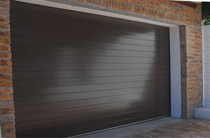 NEW ROLL UP AND SECTIONAL SINGLE AND DOUBLE GARAGE DOORS FOR SALE - WILL BEAT ANY WRITTEN QUOTE!