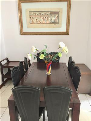 Large mahogany 10 seater with black high back chairs