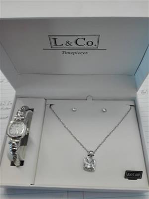 Time piece silver watch and necklace
