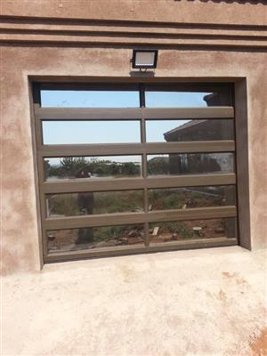 Garage doors, aluminium doots and windows, painting and electrical works.