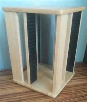 Solid oak CD rack. Holds 100 cd's. Can turn 360 degrees. In good condition.