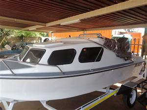 Calibre cabin with 90 Mariner with trim and tilt