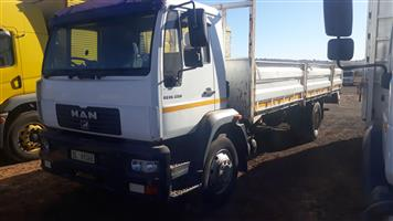 Man 18-220 fitted with dropside body