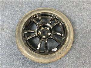 Nissan 370Z OE spare wheel, slightly scratched, but in good condition - never driven on - tyre is 100%, with wheel nuts.