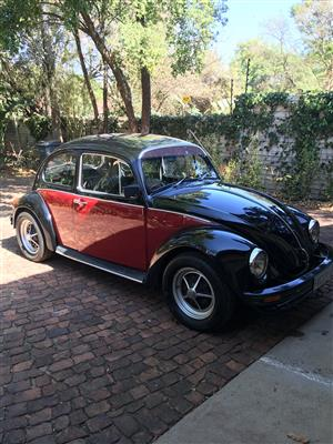 Black and red 1976 Beetle