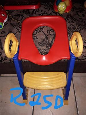 Red, yellow and blue pusher toy