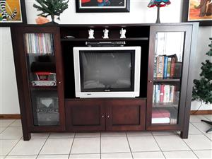 Dark wooden TV unit with cupboards