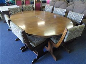 Wooden Dining Room Suite + Material 8 Chairs
