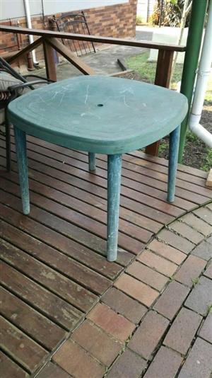 Green plastic garden table