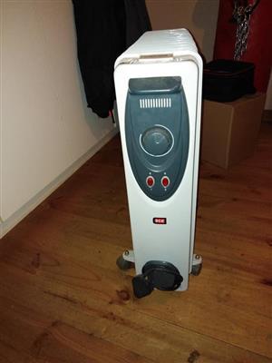 Fin oil heater