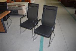 Black and silver waiting chairs .