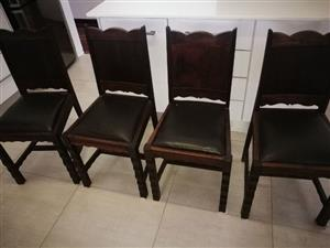4 solid wooden dining chairs