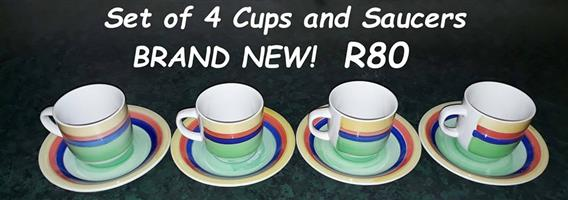 Brand new 4 cups and saucers