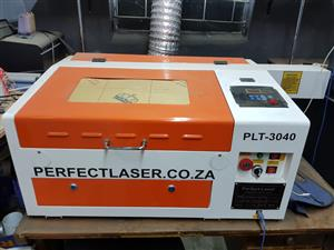 PLt 3040 laser engraver with rotatry attachment.Includes marking ink