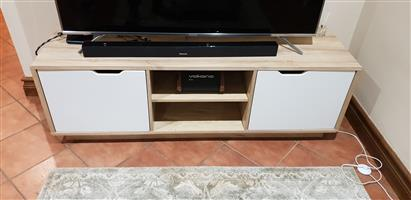 White and light wood TV stand.