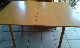 Beechwood extendable dining room table plus 4 folding chairs