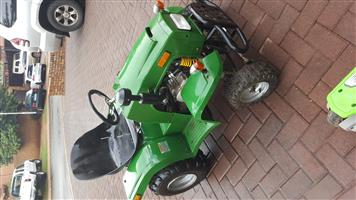 Kids rideon gas tractor with trailer