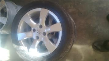 Original Peugeot 16 inch 4 hole mags for sale