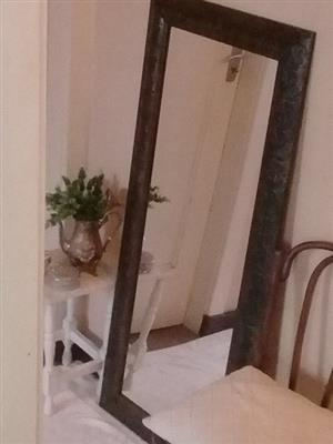 Tall, brown framed mirror for sale