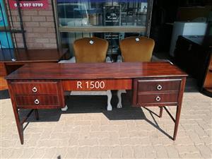 Dark wooden dresser with drawers