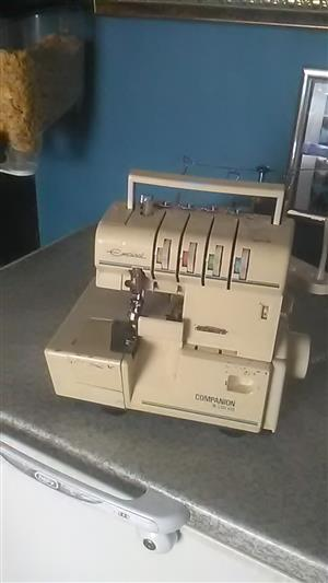Over locker sewing machine for sale