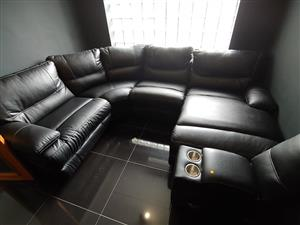 Black leather corner lounge suite