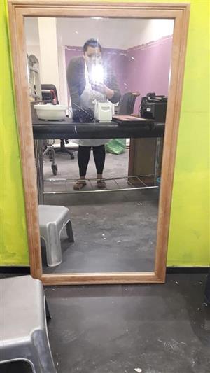 Wooden framed tall mirror
