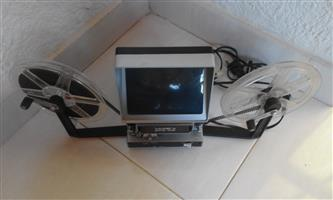 8mm Movie Viewer. For viewing and examining picture at desired speed.