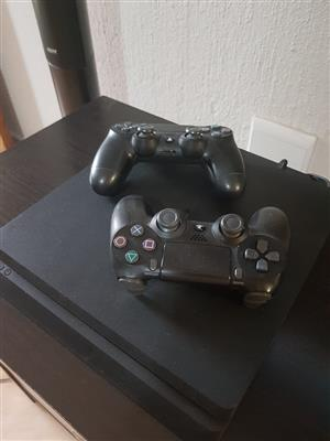 PS4 1 TB Console with 2 x wireless controls and 4 x games