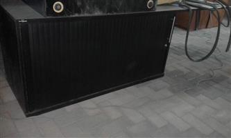 Large black sliding door cabinet