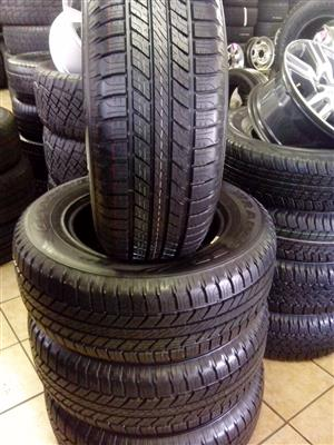 265/65/17 Goodyear Wrangler R6000 set with free fitment.