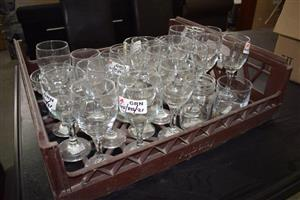 Crate full of wine glasses for sale