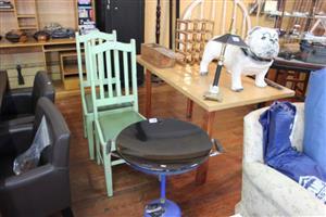 Chinese braai and green chairs