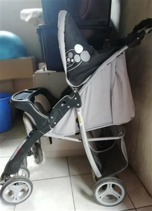 Pram, black and grey. Fully adjustable from sitting to sleeping position. Neatly maintained and in good working condition