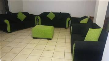 10 Seater Lounge Suite with pillows and an Ottoman