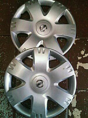 Nissan np200 original standard steal rims size 15 aset or loose and wheel caps