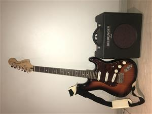 Squier by Fender electric guitar and amp