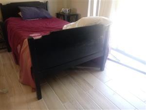 3/4 Bed with dark wooden headboard