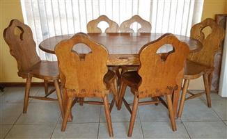 Six seater solid wood dining table and chairs