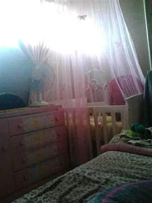 White cot with pink net for sale