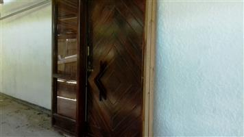 Solid wood front pivot door with glass panel good condition, to swop  for for +- 4m wooden meranti sliding door with glass